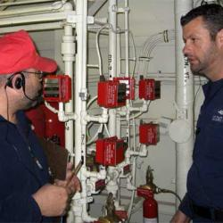 DCC Marsden conferring with Chief Boatswain's Mate Kidd