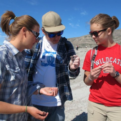 Laura Levy explains how fossils form to Kurt and Jeannie
