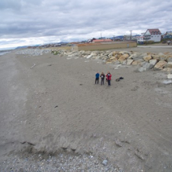View of Jennifer Johnson, Chrissy Hernandez and Lisa Seff on the beach in Nome from the drone perspective.