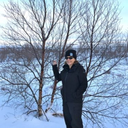 Lisa Seff with downy birch tree in Iceland.