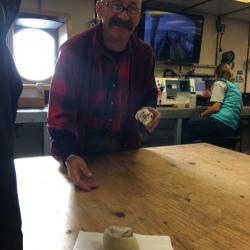 Phil passes a cinnamon bun.