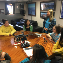 Anvil City School Science Academy school students learn about drones from Jennifer Johnson onboard the R/V Sikuliaq. Photo by Lisa Seff.  September 18, 2017.