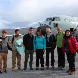 American group steps onto the tarmac, jet-lagged but smiling!
